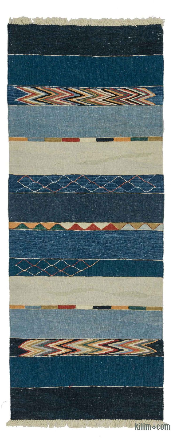 Beautifully transform your living space with our handmade, authentic and timeless new kilim rugs that carry with them many of the traditional elements that made true vintage Turkish Kilim rugs so precious. Each kilim is skillfully hand-woven in Turkey to create a beautiful piece of art. We use vegetable dyed and hand spun wool to make sure they age gracefully.This fine blue rug measures 2'4'' x 6'4'' (28 in. x 76 in.). We can customize it by adding your monogram or removing the fringes upon…
