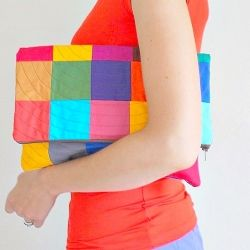 Easy tutorial for a simple but striking patchwork clutch-- a great statement accessory to add to your wardrobe. #craftgawker