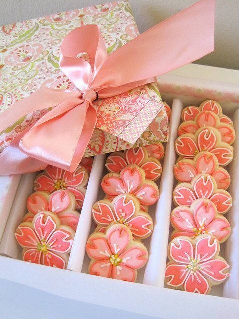 Arrange pretty sugar cookies in a box with a decorated top.