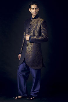 Jamevar silk indo-western sherwani with patiala embellished with velvet pattern on collar, sleeve hem and buttons.