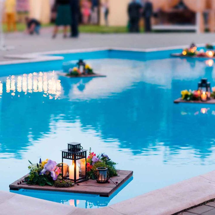 Make Them Float - If you're lucky enough to enjoy a pool or water feature in your outdoor space, add an element of surprise to your next gathering with floating lights. Store-bought, toss-in options are a quick and easy way to add glam, but for a truly remarkable effect, flex your woodworking muscle and build custom mini-pallets like those pictured. You can deck them out with candles, flowers, or anything else your party requires. If you love the idea, but don't have a water feature (yet)…