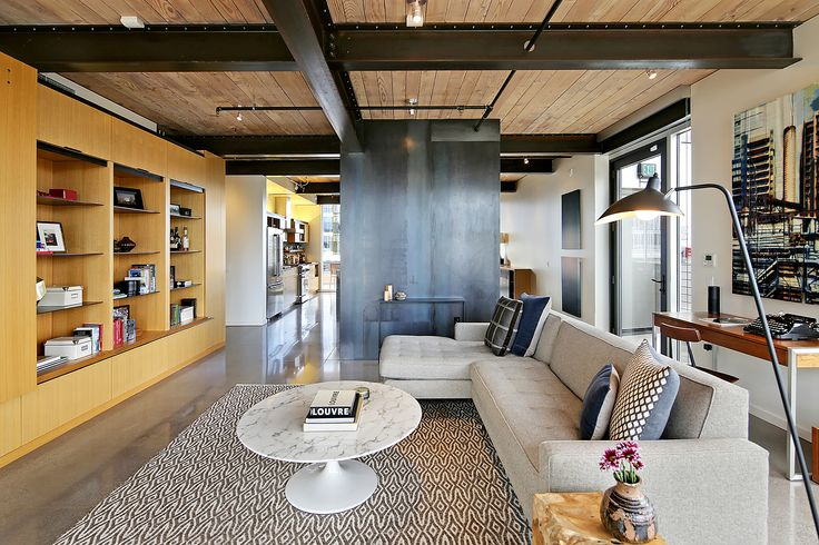 This beautiful loft-style space features a wrap-around deck, floor to ceiling windows, polished concrete floors, white oak cabinetry, blacked steel wall accents, exposed steel structure, and natural fir ceiling. This space is a design wonder and perfect to elevate any gathering.