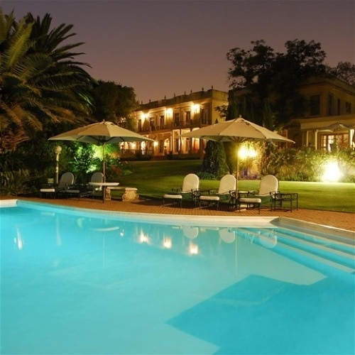Johannesburg: Luxury, Design and Boutique Hotels / vtravelled blog / Night view from pool ©Fairlawns Boutique Hotel & Spa