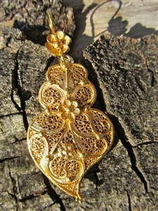These exquisite dangly earrings are a perfect example of intricate handcrafted filigree jewelry. Crafted in the traditional Coração de Viana (Viana Heart) style, hearts, flowers, dots and swirls make this ornate piece an object of envy to anyone who sees it. These big, beautiful hearts will make any woman feel loved.