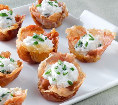 Crispy Prosciutto di Parma Cups with Goat Cheese Mousse 6 paper-thin slices Prosciutto di Parma 3.5 oz. plain goat cheese at room temperature 1 tablespoon milk 1 tablespoon minced chives Preheat the oven to 400°F. Cut Prosciutto di Parma slices in half crosswise. Press each half slice of prosciutto into each cup of a mini-muffin pan. Bake for 8-10 minutes. Combine goat cheese with milk and chopped chives until creamy. Pipe or spoon the goat cheese mousse into cooled Parma cups.