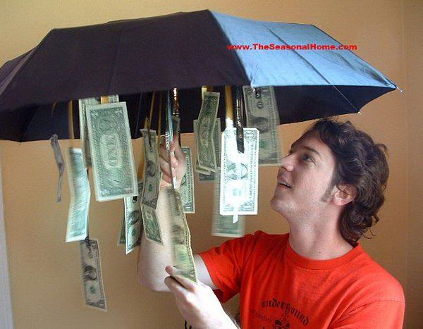 Cash Umbrella. Cut ribbons of various lengths, attach money to them and tie the ribbons inside the umbrella. The graduate must be disappointed to receive the ordinary umbrella. Once he or she opens it, the graduate must feel very exciting. I really enjoy this humorous gift. http://hative.com/graduation-cash-gifts/