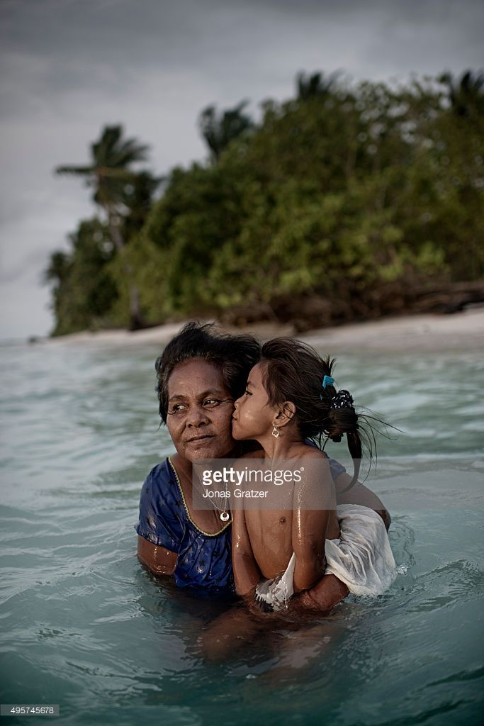 A mother and her daughter taking a dip in the sea. Their land is on the northernmost part of the Tarawa atoll which is slowly being consumed by the sea. The people of Kiribati are under pressure to relocate due to sea level rise. Each year, the sea level rises by about half an inch. Though this may not sound like much, it is a big deal considering the islands are only a few feet above sea level, which puts them at risk of flooding and sea swells. It is well agreeable that the people of…