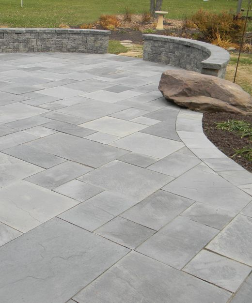 Grey ashlar pattern stone patio interrupted by native boulder. This shows  the blurring of the line between the built environment into the natural  landscape. - 25+ Best Ideas About Paving Stone Patio On Pinterest Patio Ideas