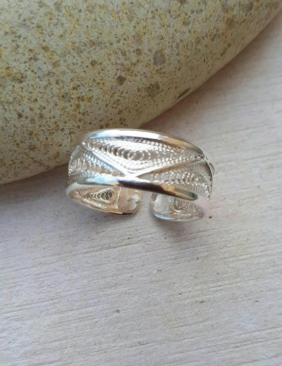Check out this item in my Etsy shop https://www.etsy.com/uk/listing/555238646/filigree-ring-handmade-ring-silver-ring