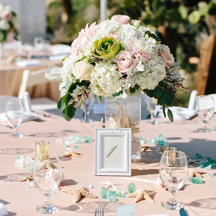 Seaglass, starfish and shells are perfect additions to a pink and white beach wedding ~ http://www.weddingchicks.com/2016/03/03/pink-and-white-beach-wedding/