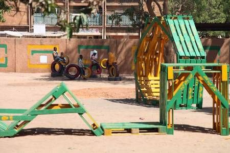 Playground structures made with recovered pallets. Photo