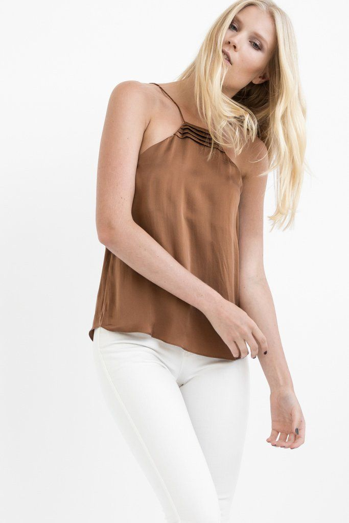 """DETAILS:  2 in 1 CAMISOLE is designed to be worn two way: front and back Darts near breast area Modern trapezium neck linewith our NEVILLEE signature design  FIT:  Relaxed fit For a super relaxed fit stick to your regular sizingOR fora fitted look (around the body), go a size down.  Brittwears size XS. She is 5'95,"""" Bust 32,"""" Waist 25,"""" Hips 36"""" FABRIC:  Pre-shrunk 100% Premium Diamond Wash Silk® - super soft silky touch. Silk is light-weight and breathable which means, cooling in…"""