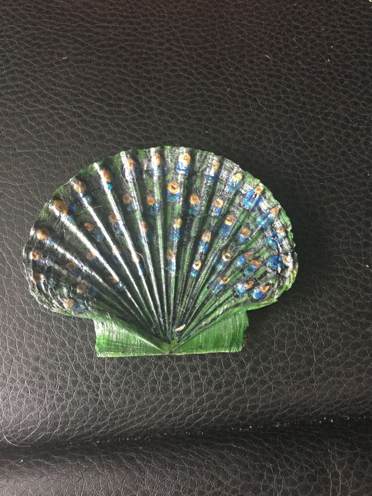 Another peacock tail painted on a scallop shell