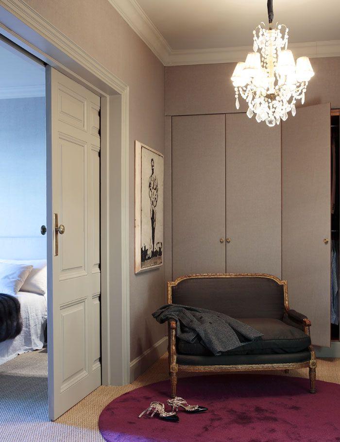 Grey master suite dressing room w/ paneled pocket door. love the colors together.