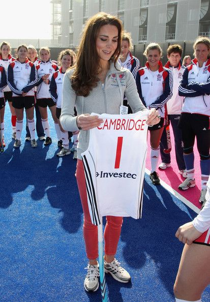 Catherine, Duchess of Cambridge is presented with a bespoke hockey shirt as she meets the GB Hockey team at the Riverside Arena in the Olympic Park on March 15, 2012 in London.