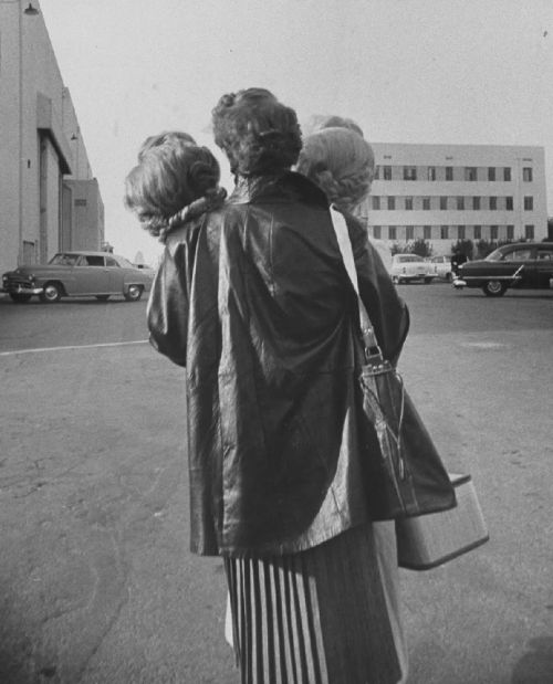 """desimonewayland:  """" Actress, Sheree North, carrying her two wigs. Loomis Dean, 1955  """""""