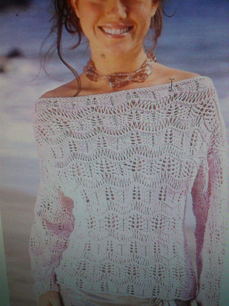 Sweater con listas de punto calado y vueltas de puntos caídos. Un modelo femenino de gran efecto.
