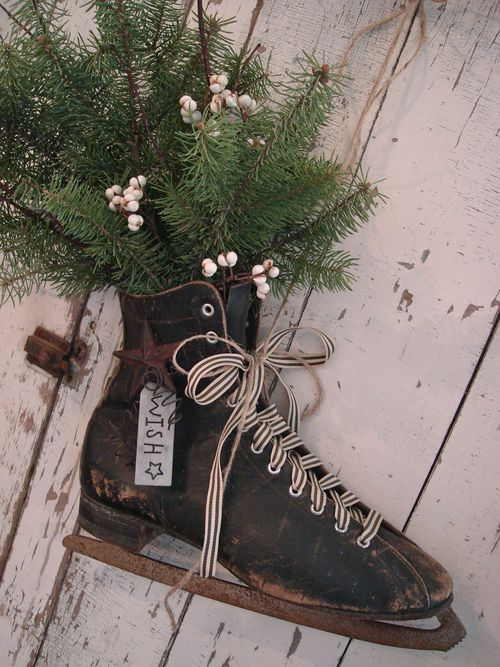 Decorative old skate with holiday greenery