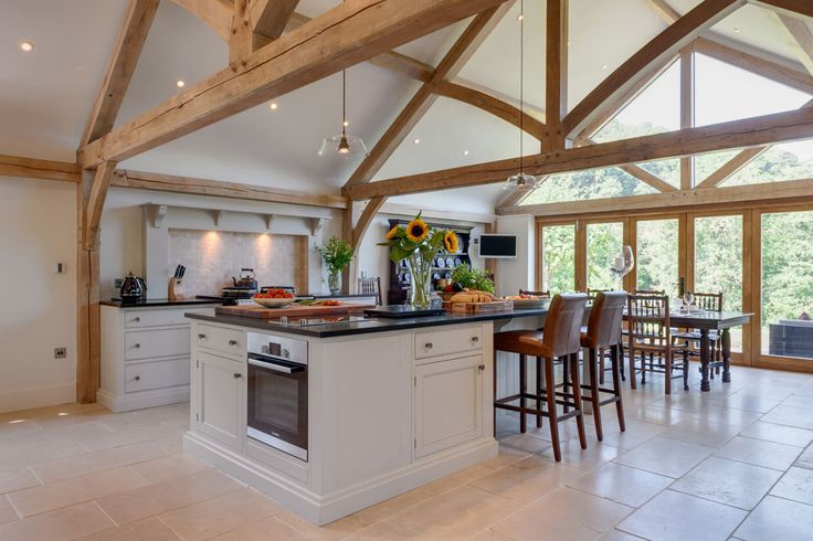 Beautiful oak frame kitchen extension from Welsh Oak Frame with exposed oak beams and trusses. www.welshoakframe.com A perfect example of how traditional oak frame can be used in a contemporary property. #kitchenextension #oakframe #contemporarykitchen #oakbeams #kitchenideas