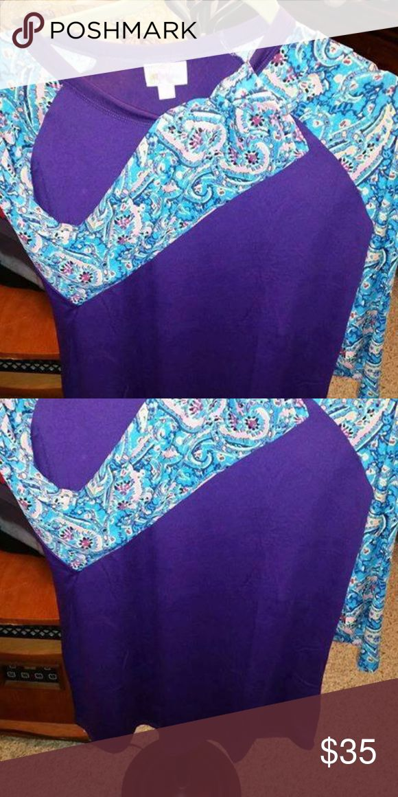 Lularoe Randy Lularoe randy. solid purple body with printed sleeves - new- fits true to size. 3/4 sleeve LuLaRoe Tops Tees - Long Sleeve