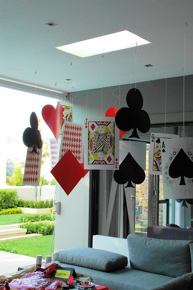 Giant cards, spades, diamonds, hearts hung from the ceiling