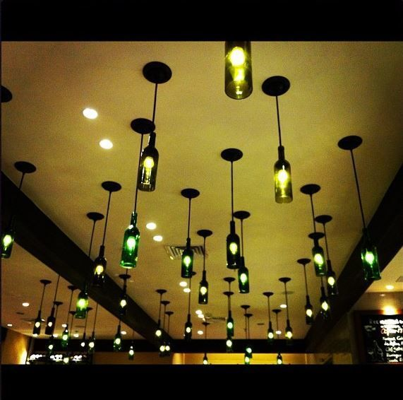 Look at these cool hanging wine bottles with lights.