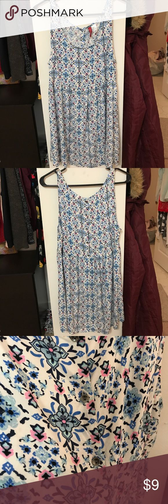 Blue and White Patterned Casual Dress A short stylish dress perfect for any occasion. It's comfortable, flowy, and causal. Divided Dresses Mini