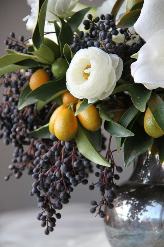 Love this Winter Flower Story! Foraged from the yard, this Renaissance painting worthy display of berries, kumquats, amaryllis blooms and Alba Plena Camellia would bring depth and drama to the winter tablescape.