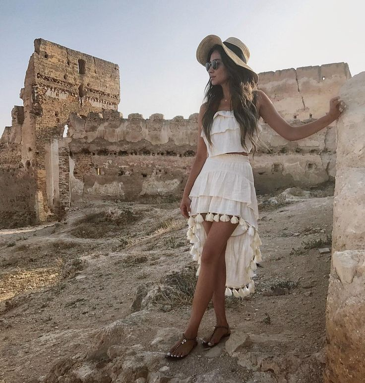 Love Shay Mitchell's white dress with tassel hem. Perfect summer outfit.