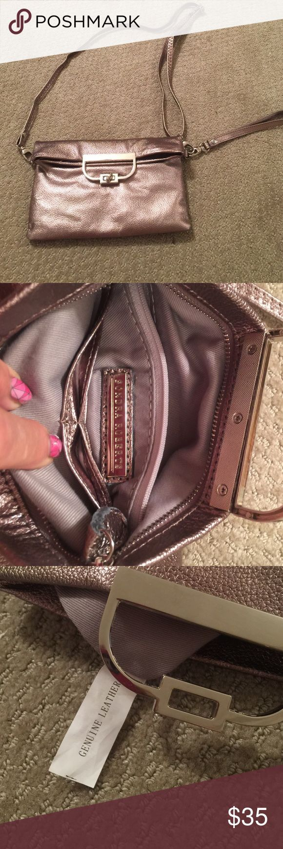 Small Leather Purse Wristlet This bag is like new because it was never used. It is leather. From a smoke free home and pet free home. It was from Nordstrom. It is more of a copper color. It has slots for credit cards. Sondra Roberts Bags Mini Bags
