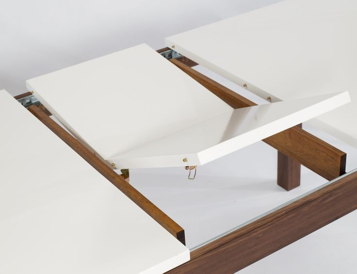 Dining Table A versatile and extremely robust butterfly extension table, constructed from solid American black Walnut with a striking, high gloss white top.  Table Dimensions: L1600mm x W900mm x H750mm (L2000mm when extended)
