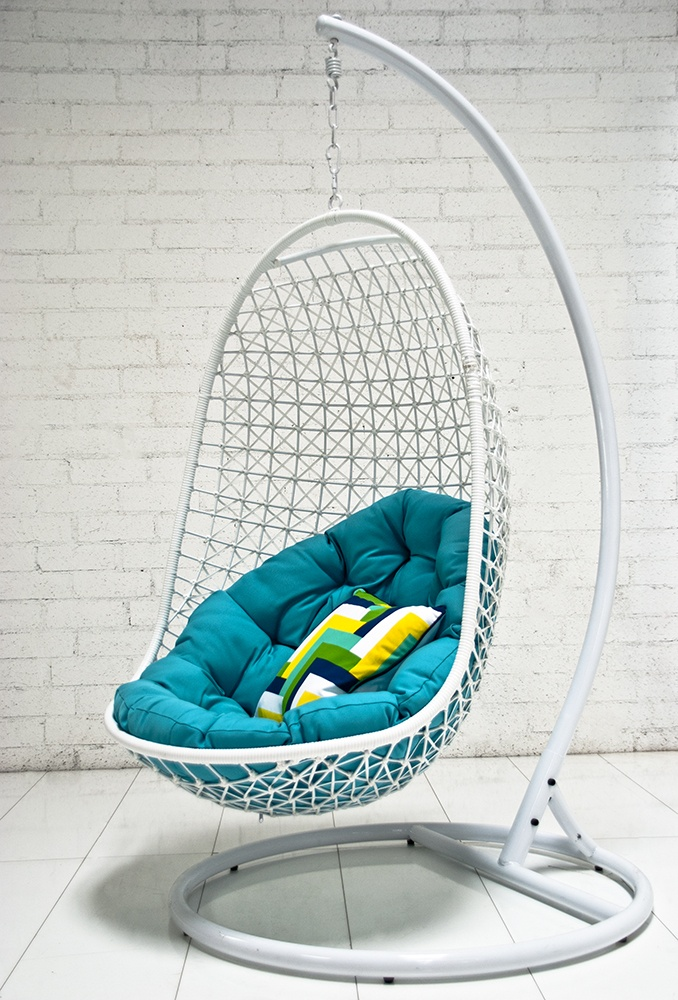 The woven Rattan outdoor hanging chair with turquoise cushion by ModShop