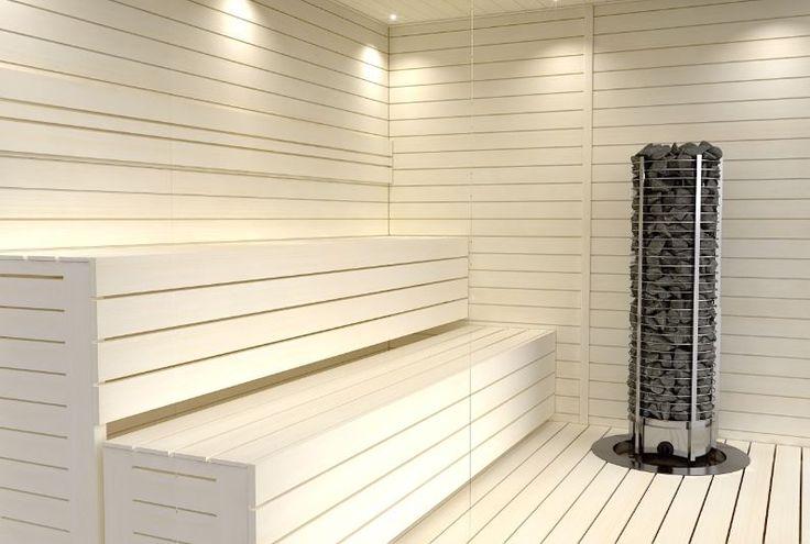 Perinteistä poikkeava valkoinen sauna. Tummempi massiivinen tornikiuas korostuu…