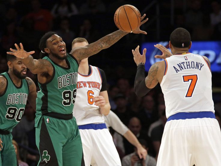 Boston Celtics forward Jae Crowder (99) defends New York Knicks forward Carmelo Anthony (7) during the second half of an NBA basketball game at Madison Square Garden. The Celtics defeated the Knicks 97-89.  Adam Hunger-USA TODAY Sports