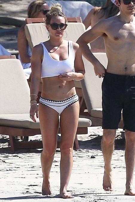 Hilary Duff wearing Same Swim the Babe Bandeau Bikini Top and Beth Richards Knot Top Bikini Top