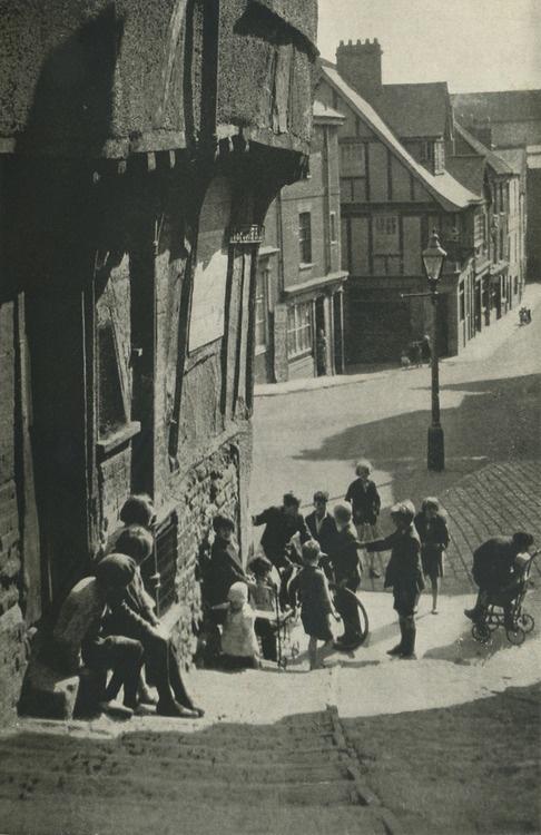Children play on the street in Exeter, Devon, UK 1930, no ...