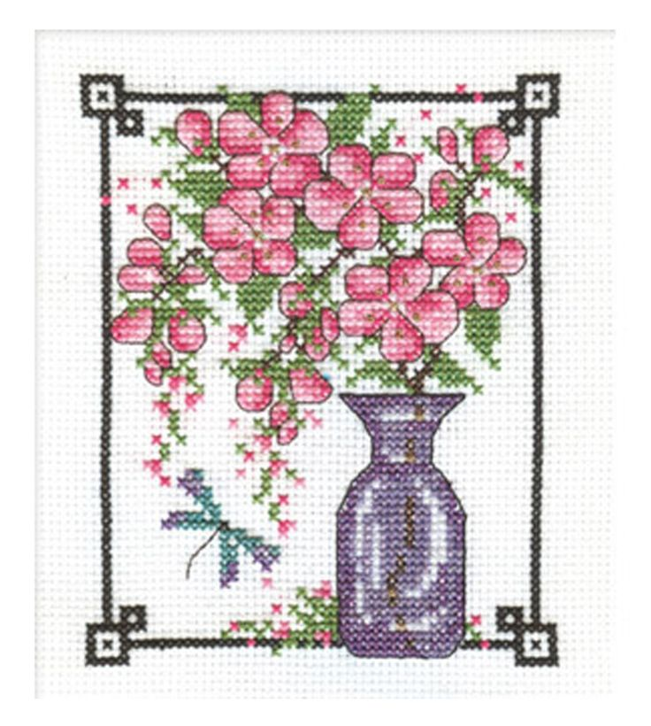 Cherry Blossom using DMC Light Effects threads. Download free project sheet here: http://dmc-usa.com/Inspiration/Projects/Light-Effects-Cross-Stitch/Light-Effects-Cherry.aspx