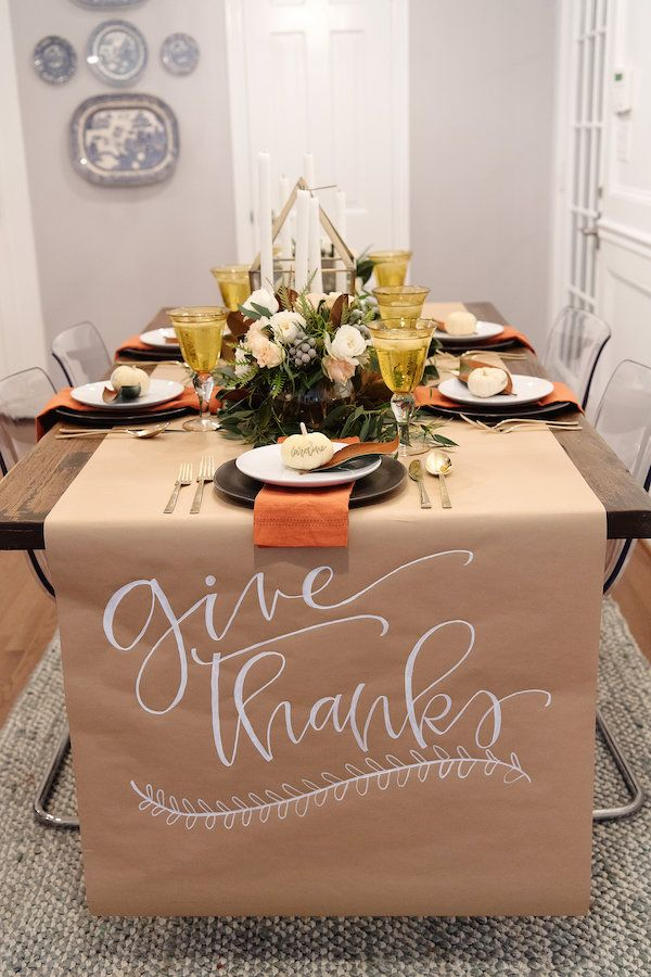 thanksgiving table setting inspiration with calligraphy and magnolia leaves