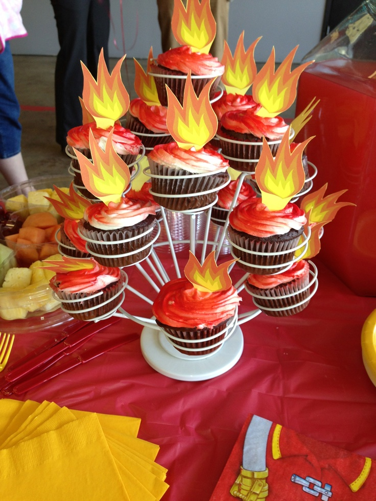 Firefighter Birthday idea: Flaming cupcakes! homemade chocolate cupcakes with cream cheese icing. i used the red spray coloring and printed a free flame template onto yellow card stock to create the toppers. this cucpake stand worked perfectly!