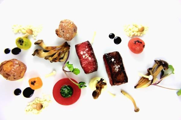 Beef & Mushrooms: souse vide steak, warm tomato gel, reverse spherification of chimichurri, truffle potato, oyster mushroom, beech mushroom, inoki mushroom, olive oil powder, balsamic reduction, baby heirloom tomatoes, black Cyprus sea salt.  A creation by Celsius Cuisine & Catering