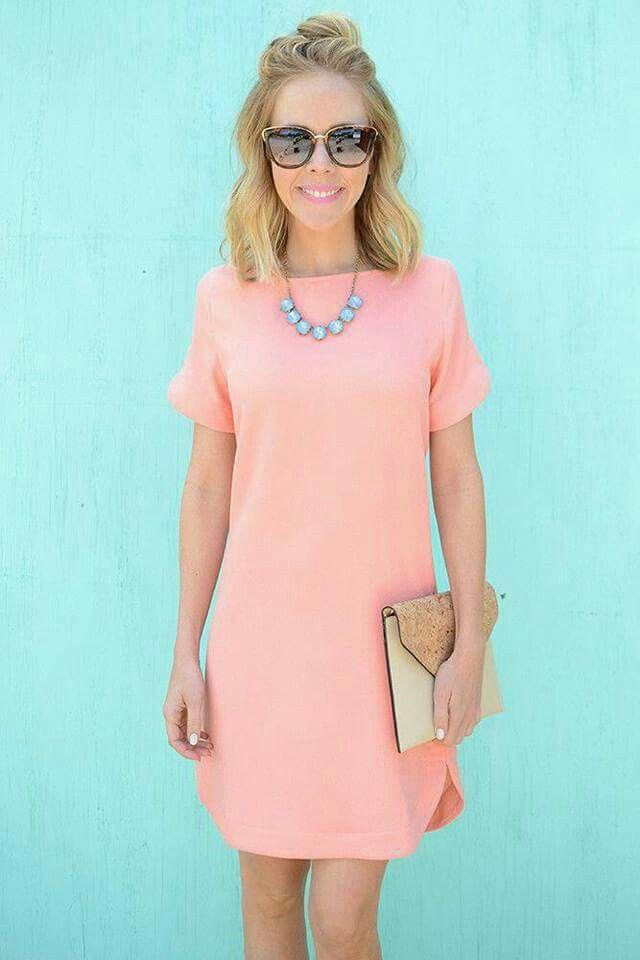 Short pink dress, blue necklace