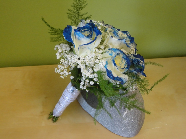 hand tied bouquet with roses dipped in blue and baby 39 s