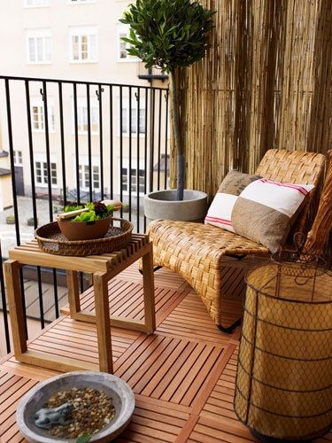 23 Amazing Decorating Ideas for Small Balcony I like the wall and tall tree. Maybe cover one wall with the brown burlap or flowery white fabric? Use a fake tree? Can I put fake branches between benches in corner?