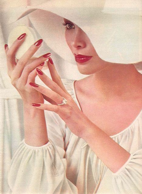 Model with red lipstick and and nails, 1976.
