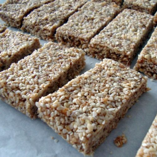 almond butter cocounut sesame bars. made these & loved them but they are a little sticky, upping the coconut to a full cup helped - thecopycatcook
