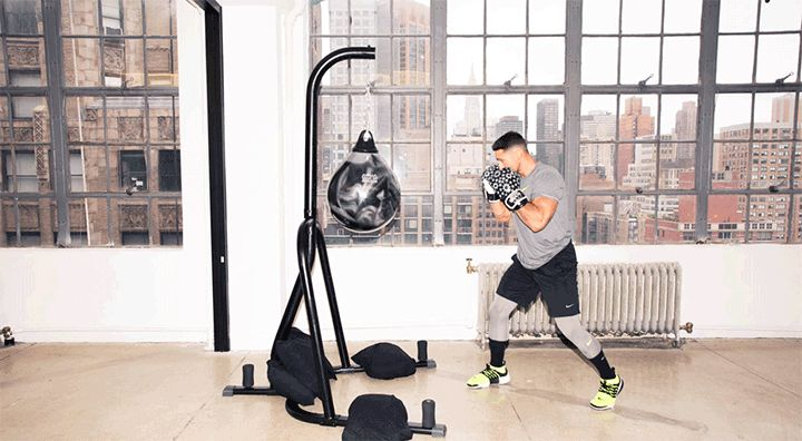 Rumble's Co-Founder Shares a Boxing Workout for Your Butt: Boxing is more than punching and ducking (and imagining your ex's face on a bag). It can also be one hell of a lower-body workout. Don't believe us? Just try the 10 butt-lifting combos that Noah Neiman, the trainer and co-founder of Rumble (NYC's newest, you guessed it, boxing studio), created just for us.—How to do a combat burpee. | coveteur.com
