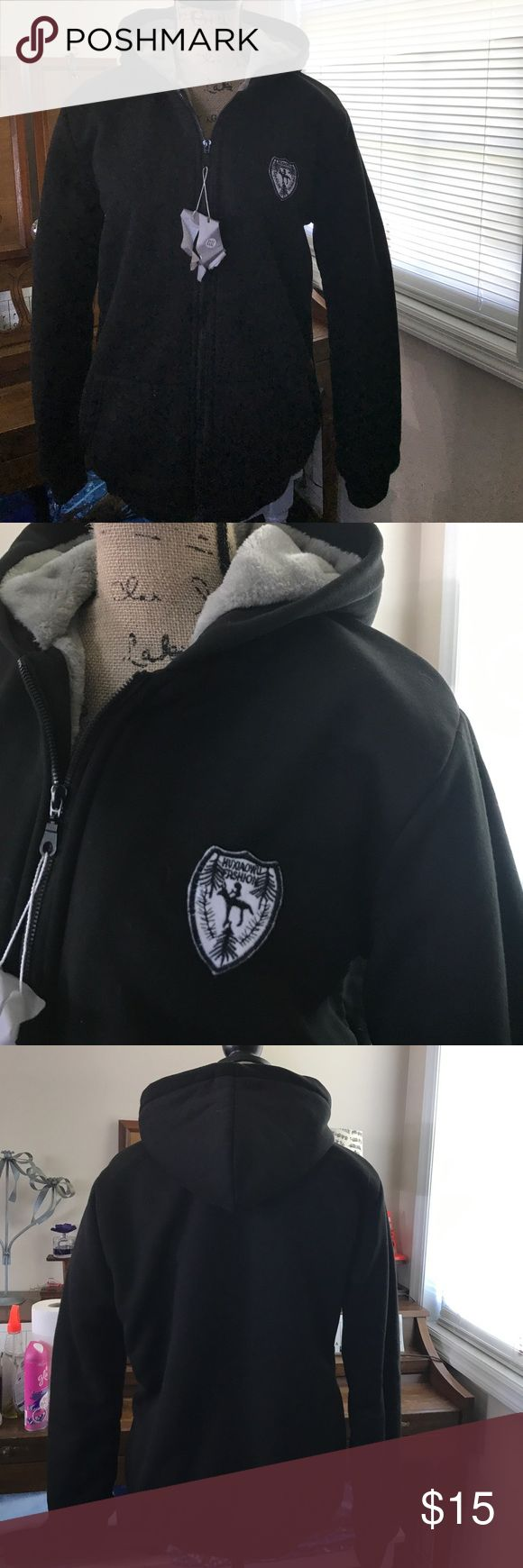 Fur Lined Hoodie Black hoodie with silver fur like lining. Never worn before. Received as a Christmas present and didn't ever wear. I cannot find a size tag but fits like a large medium or small large. Nice and warm. Zips all the way down in the front. Excellent condition. Jackets & Coats