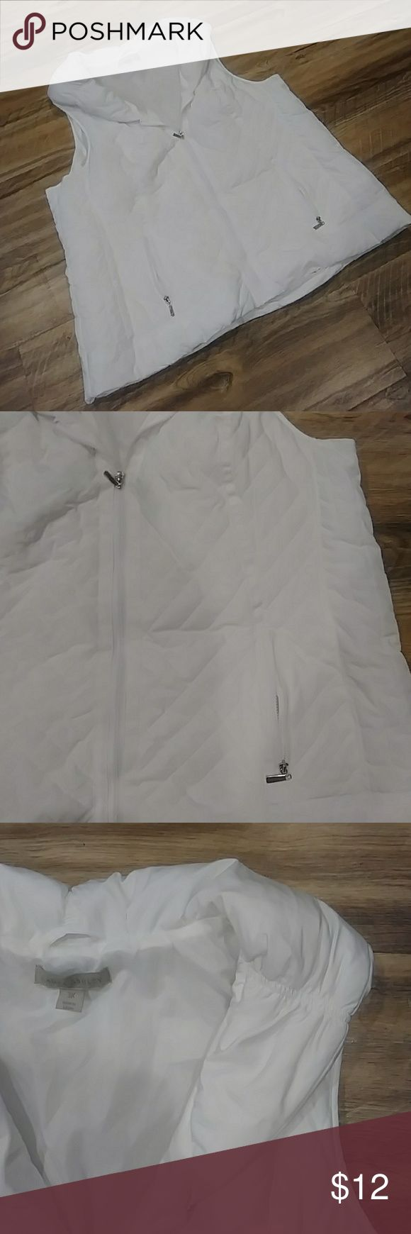 NWOT white quilted vest Never worn. Quilted with puffier collar and silver hardware. I took off the tag and noticed a hole pattern at the armpit I didn't like. It's exactly the same on both sides so it's suppose to be like that. Laura Ashley Jackets & Coats Vests