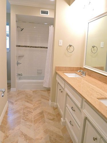Renovation #2 - jack 'n jill bathroom with chevron tile floors, subway tile shower, travertine counters, double vanity