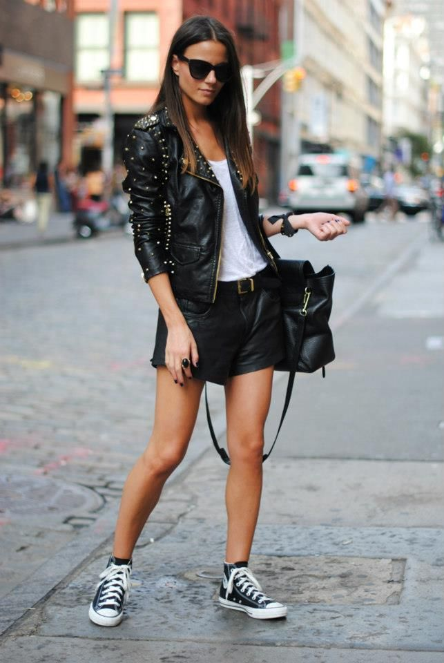 Black leather studded jacket , leather shorts and black converse shoes